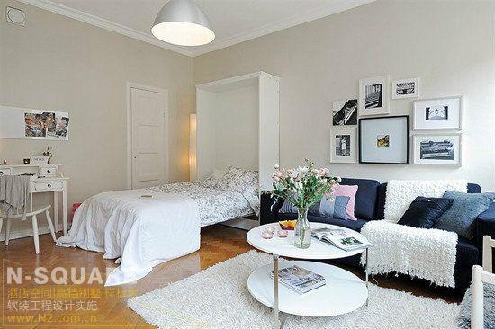 由白色与黑色的家具打造的卧室